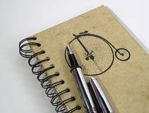 Notitieboekje en Pen stock afbeeldingen