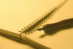 Notitieboekje en pen Stock Fotografie