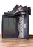 Notitieboekje en schoenen Stock Fotografie