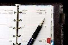 Notitieboekje, kalender en pen Royalty-vrije Stock Fotografie