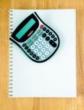 Notitieboekje met calculator Royalty-vrije Stock Afbeelding
