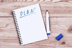 Notitieboekje met een actieplan Royalty-vrije Stock Afbeelding