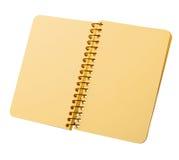 Notitieboekje met gele pagina's op een spiraal Royalty-vrije Stock Foto