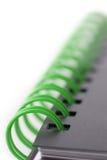Notitieboekje met groene spiraal Stock Foto's