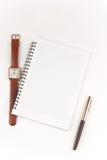 Notitieboekje, pen en polshorloge Royalty-vrije Stock Foto's