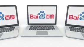 Notitieboekjes met Baidu-embleem op het scherm Computertechnologie het conceptuele redactie 3D teruggeven Stock Fotografie