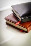 Notitieboekjes met rood lusje Stock Afbeelding