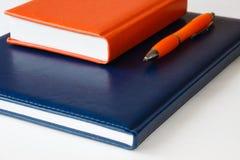 Notizbücher und Stift Stockbilder