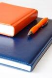 Notizbücher und Stift Lizenzfreies Stockfoto
