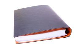Notizbuch auf einem weißen Hintergrund stockfotografie