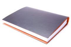 Notizbuch auf einem weißen Hintergrund Lizenzfreie Stockfotografie