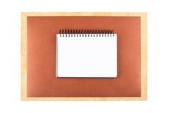 Notizbuch auf strukturiertem Papier Stockfotos