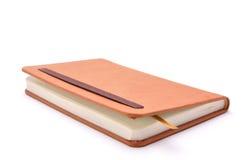 Notizbuch für Aufzeichnungen auf einem weißen Hintergrund Lizenzfreies Stockbild