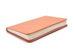 Notizbuch für Aufzeichnungen auf einem weißen Hintergrund Lizenzfreie Stockbilder