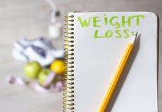 Notizbuch für Gewichtsverlustherausforderung Lizenzfreies Stockbild