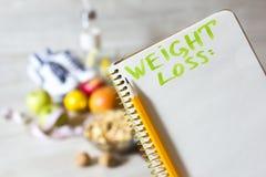 Notizbuch für Gewichtsverlustplan und Lebensmittel der gesunden Diät Lizenzfreie Stockfotografie