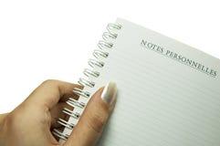 Notizbuch getrennt worden auf weißem Hintergrund Lizenzfreies Stockfoto