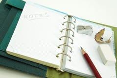 Notizbuch mit Bleistift und Radiergummi Stockfotografie