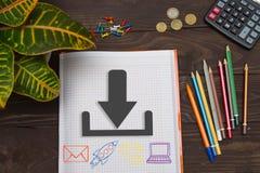 Notizbuch mit einem Anmerkungsdownload auf dem Bürotisch mit Werkzeugen C Lizenzfreie Stockbilder