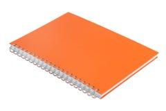 Notizbuch mit einer orange Abdeckung Stockbild