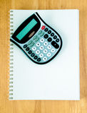 Notizbuch mit Rechner Lizenzfreies Stockbild