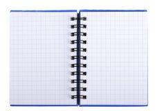 Notizbuch mit Seiten in einem Käfig mit einer Spirale Lizenzfreie Stockfotografie
