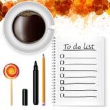 Notizbuch mit a zu-listen, ein Tasse Kaffee und ein Lutscher auf Lizenzfreie Stockfotos