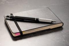 Notizbuch und Bleistift Stockbild