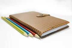 Notizbuch und Bleistifte Lizenzfreies Stockbild