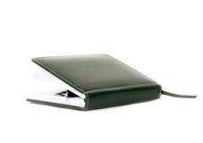 Notizbuch und eine Feder Lizenzfreie Stockbilder