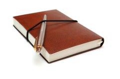 Notizbuch und Feder Stockbild