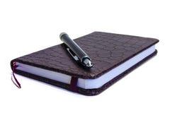 Notizbuch und Griff Lizenzfreie Stockbilder