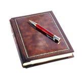 Notizbuch und rote Feder Lizenzfreies Stockbild