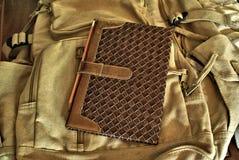 Notizbuch und Rucksack Stockfoto