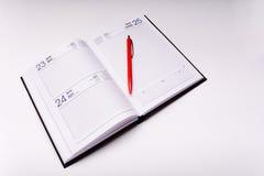 Notizbuch und Stift Stockbild