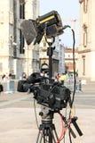 Notizie della registrazione della videocamera della televisione Immagine Stock