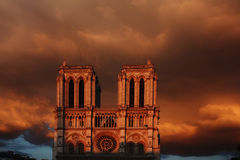 Notre Dame. At sunset against an orange cloud backdrop. Paris, France royalty free stock images