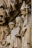 Notre Dame. Statues at the entrance of Notre-Dame cathedral in Paris Royalty Free Stock Photography