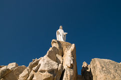 Notre Dame. Statue of the virgin Mary on a rock royalty free stock photo