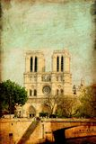 Notre dame. Grunge image Notre dame cathedral in Paris on a blue sky Royalty Free Stock Photos