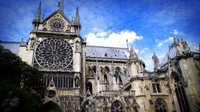 Notre Dame against blue sky, Paris, France. Notre Dame contrasted against wispy clouds and a blue sky, Paris, France Royalty Free Stock Images