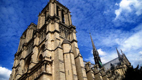 Notre Dame Against the Clouds, Paris, France. Notre Dame contrasted against wispy clouds in Paris, France Stock Photo