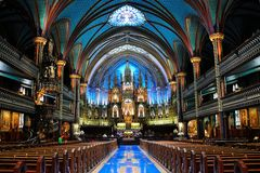 Notre Dame Basilica. Notre-Dame Basilica (French: Basilique Notre-Dame de Montréal) is a basilica in the historic district of Old Montreal, in Montreal, Quebec Stock Image