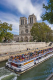 Notre Dame and bateaux Mouches Royalty Free Stock Images
