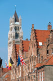 Notre dame Belfry and flags at Brugge - Belgium Stock Photo
