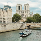 Notre Dame  with boat on Seine, France Stock Photography
