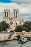 Notre Dame  with boat on Seine, France Stock Image