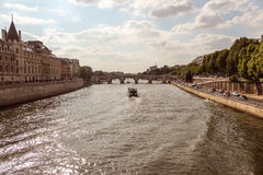 Notre Dame  with boat on Seine, France Stock Images