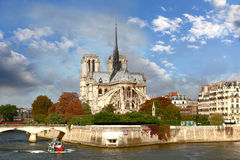 Notre Dame with boat on Seine in Paris, France Stock Images