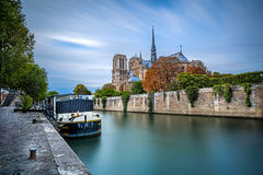 Notre Dame with boat on Seine in Paris, France. Back of Notre Dame Cathedral across Seine River, Paris, France Stock Photo